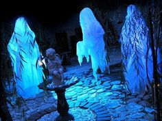 Life size ghosts made out of chicken wire and cheesecloth