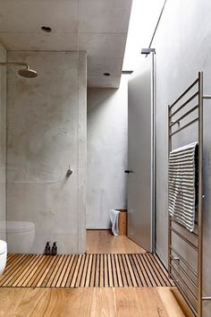 Love this light wood against the grey walls. Such a beautiful bathroom!
