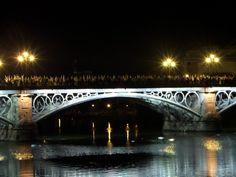 Semana Santa, Sevilla #semanasanta #holyweek #nazarenos #bridge #puentedetriana #night #lights #easter #culture #travel #adventure #discovery