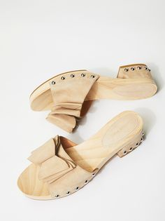 Aida Clog | Slip-on wooden clogs featuring a suede band with bow detail and metal stud accents. * Rubber sole * Wrapped square heel