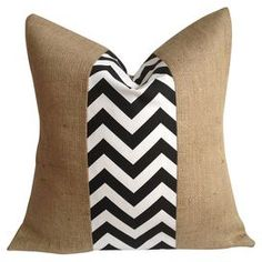 "Eco-friendly burlap pillow with a chevron-patterned fabric stripe in black. Made in the USA.  Product: PillowConstruction Material: 100% Natural burlap and cotton cover and down fillColor: Black and whiteFeatures:  Made in the USAEco-friendlyInsert included Dimensions: 20"" x 20""Cleaning and Care: Spot clean"