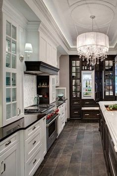 love the dark old cabinet look with the dark counter and lighter cabinets and the glass fronts