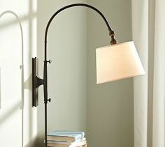 Adjustable Arc Sconce, pottery barn- love this- plug in so not permanent! 279 for a pair