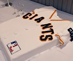Amazing Giants Jersey CAKE from Amaru Confections (based in Boise, Idaho).  They specialize in creating unique one-of-a-kind confections for weddings, private parties, birthdays, baby showers, corporate events and other special occasions.  Excellent work on the sleeve and jersey letters!