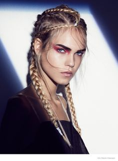 EcoRebel–Appearing in an editorial for Volt Magazine online, model Line Brems tries on six different braided hairstyles for this beauty feature captured by Martin Petersson. The blonde beauty channels her inner rebel, breaking all the rules with colorful lipstick, twisted tresses and smokey eye makeup. Åsa Elmgren worked on makeup with hair by Joe-Yves Asmar and styling by Gorjan Lauseger.