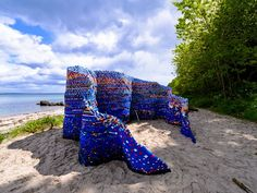 Waves Structure out of 70,000 Discarded Plastic Bottle Caps byArunkumar H.G.