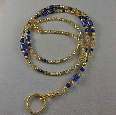 Cobalt Blue & Gold Cane Glass Lanyard Badge Holder made with Swarovski Crystals $27.89 Beaded Jewelry, Beaded Necklace, Beaded Bracelets, Cobalt Blue, Blue Gold, Beaded Bookmarks, Lanyard Necklace, Beaded Lanyards, Wire Wrapped Bracelet