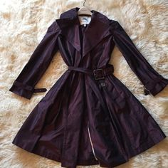 Authentic Burberry rain coat This Burberry raincoat is stunning. The detail to the color is a showstopper. Brand new. Comes with hanger. Burberry Jackets & Coats Trench Coats