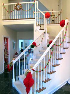 The main stair at Christmas.  Garlands from Target; paper ornaments from JCP.
