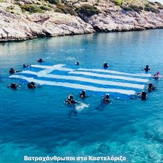 People swimming in the sea in Lindos Rhodes Greece with the Greek Flag On Greek Independence Day Corfu Beaches, Greek Independence, Myconos, Greek Flag, Greece Pictures, Corfu Island, Greece Islands, Most Beautiful Beaches, Thessaloniki