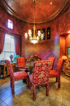 Love this distinctive rounded formal dining room in DC Ranch!