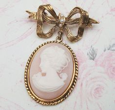 Pretty pearls set into a bow that suspends a charming pink Vintage Cameo!