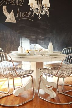 modern chairs, classic table, chandelier, chalkboard wall...