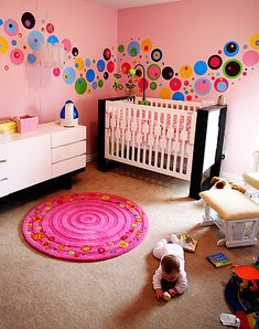 Bright pink and colourful baby girl's nursery bedroom