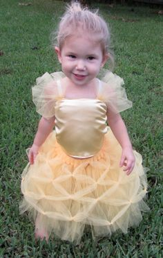 Disney's Belle Inspired Tutu 3pc Set - Yellow Tutu, Yellow Satin Bodice W/Yellow Tulle, and Matching Tulle Wand. $44.00, via Etsy.