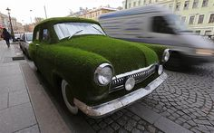 Image: A customized Soviet-era Volga GAZ-21 vintage car covered by artificial grass in St. Petersburg. (© Alexander Demianchuk/Reuters)
