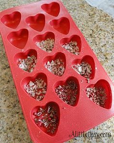 Sprinkle nuts, salt, candy cane pieces or other candies on the bottom of the mold tray before pouring on the chocolate for fancy chocolates.