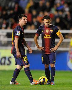 Xavi Hernandez y Messi