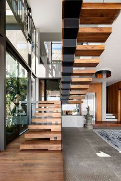 Top 10 Unique Modern Staircase Design Ideas for Your Dream House Modern Staircase Design Ideas – Stairways are so common that you don't give them a doubt. Look into best 10 examples of modern staircase that are as magnificent as they are … Wooden Staircase Design, Home Stairs Design, Floating Staircase, Wooden Staircases, House Design, Stair Design, Railing Design, Stairs Architecture, Interior Architecture