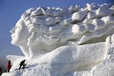 Wider angle views give more perspective on just how large these temporary works of art are. Some of the packed snow creations climb over 100 feet into the air.