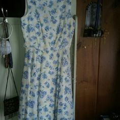 Pretty dress Pretty flowered dress from Victorias secret. Only worn once and dry cleaned. Still in dry cleaning bag. Has a v neck back and belt. Sz 2. Moda International Dresses