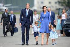 On Monday he looked a little overwhelmed on arriving in Poland, and today Prince George still appeared to be feeling a bit shy