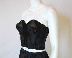 1950s Black Satin Longline Strapless Bra, 36 B, Lady Marlene Caprice Rayon by IntimateRetreat on Etsy https://www.etsy.com/listing/463155474/1950s-black-satin-longline-strapless-bra
