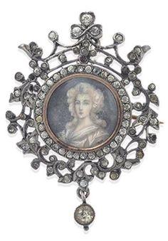 A GEORGIAN MINIATURE PORTRAIT BROOCH. The miniature portrait set within a decorative border of paste and seed pearls. #Georgian #miniature #brooch