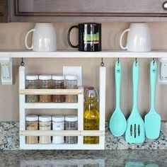Easily customize the shelf and hooks for your space, plus plans for an optional spice and oil bottle caddy.