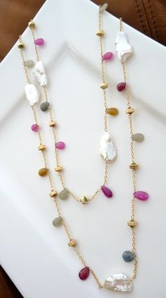 Lovely multicolored briolette beads on chain.