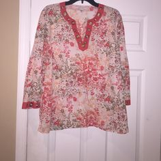 Spring colored tunic with brass embellishments This cute spring clouded top has been gently used. All the brass embellishments are in tact and comfy with jeans. Tops Tunics