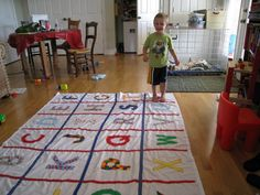 Alphabet Mat!  Cloth letters sewn on a simple twin bed sheet - such a good way to work on learning letters!