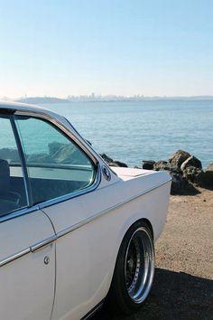BMW e9 | BMW | classic cars | classic BMWs | car on beach | white BMWs