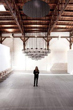 """Village"" of white cubes built inside a former warehouse in Copenhagen."