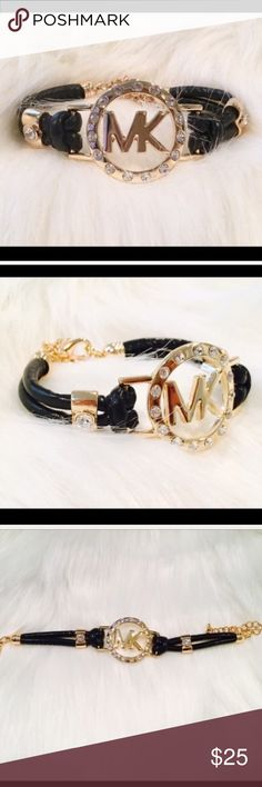 Gorgeous MK Black Leather Bracelet! Gorgeous MK Black Leather Bracelet!                                 ❤️Brand New and High Quality  ❤️This is NOT Michael Kors, but a beautiful bracelet-identical to MK!  ❤️ Always 5 stars item! ⭐️⭐️⭐️⭐️⭐️ ❤️They sell fast !!! Don't miss it!! ❤️ Jewelry Bracelets
