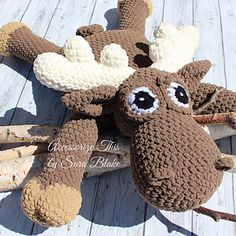 """Peanut"" the Moose is my new favourite Pillow Buddy!! He's the perfect pal for the little one in your life. Ideal décor for a nursery or cuddling up for a movie. So soft and cuddly, measuring approximately 3 feet, this guy still works up quickly with Super Bulky Bernat Blanket Yarn."