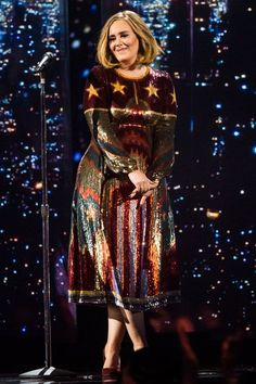 30 Looks That Mean Adele — & Her Style — Is Back In Action #refinery29  http://www.refinery29.com/2016/04/106993/adele-lookbook-street-style-photos#slide-2  We're being totally serious when we say this: Miss Frizzle, you need this dress in your life....