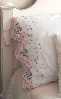 Helene's Legacy: Making Good Use of Those Vintage Hankies.... lots of ideas!  I just liked this one best.  Looks like the hanky was cut into quarters and applied to the edge of the pillowcase.