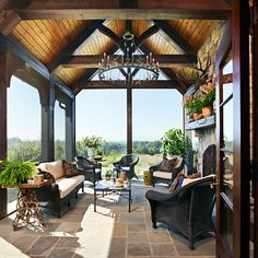 Porch View - love the dark woods and wicker on this porch - not to mention the gorgeous view...