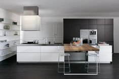 You can choose modern or classic kitchen island designs. Here you will also find two examples. We have prepared for you a great photo gallery.