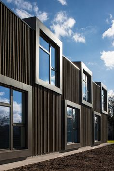Timber construction facade school house and double kindergarten in Sisseln Expressing the material wood – Outside, the material wood appears as a dark shell painted with Sc Architectural Design House Plans, Architecture Design, Kindergarten Architecture, School Building, Design Process, Facade, Skyscraper, How To Memorize Things, Multi Story Building