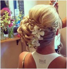 Curled beachy theme hair up-do, very pretty and elegant