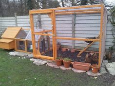 Chicken Coop against a Fence