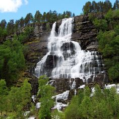 Located between Voss and Flåm off the E16 highway, the picturesque Tvindefossen waterfall has become a large attraction for travelers. Over 200,000 people have been estimated to visit the falls each year. In addition to its beauty, legend has it that a drink from the falls will give one a long lo...