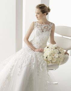 Intricate beadwork patterns, classic silhouettes, sheath wedding dresses with beaded back details, dropped waist ball gowns, Two by Rosa Clara wedding dresses 2014 bridal collection is perfect for an ultra-modern chic bride.