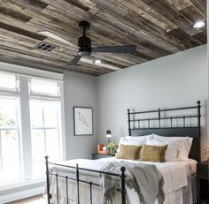 The most unique thing about the master bedroom is the raw wood ceilings made with wood salvaged from the original house's structure. It added such a fun texture and a unique element to remind this family of where this house started.