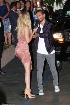 Close pals: Khloe and her (sort of) brother-in-law Scott Disick were seen chatting as they made their grand arrival at the venue