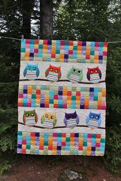 This is Evelyn's Whoo's Your Baby quilt and the pattern can be found in the book Jelly Babies by Karen Costello.   When she was working on this quilt at our guilds Spring Retreat I was looking at the