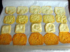 Preheat the oven to 400*. Line a large baking sheet with parchment paper. Place the cheese slices on the paper with about 1 inch in between - I can get 4 x 5 rows.  Put them in the preheated oven for 8 to 10 minutes, it will vary with your oven.  Watch them after the first 7 to 8 minutes, you want them to be JUST browning up around the edges a bit and they'll get all bubbly. Remove from oven and let stand a minute, blot up the excess oils.
