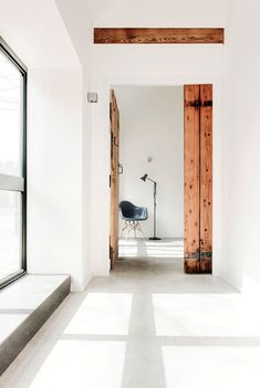 Interior Styling | Rustic Doors second hand, recycled wood beams used as door and frame, against white walls stands out perfectly, modern apartment mixed with rustic wood accents